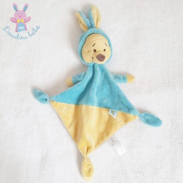 Doudou plat Winnie bleu jaune DISNEY