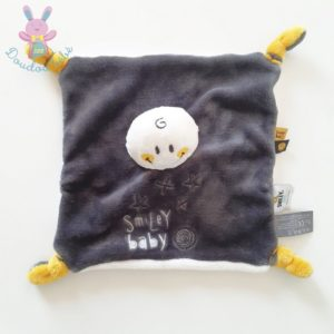 Doudou plat Smiley baby noir blanc jaune étoiles ORCHESTRA